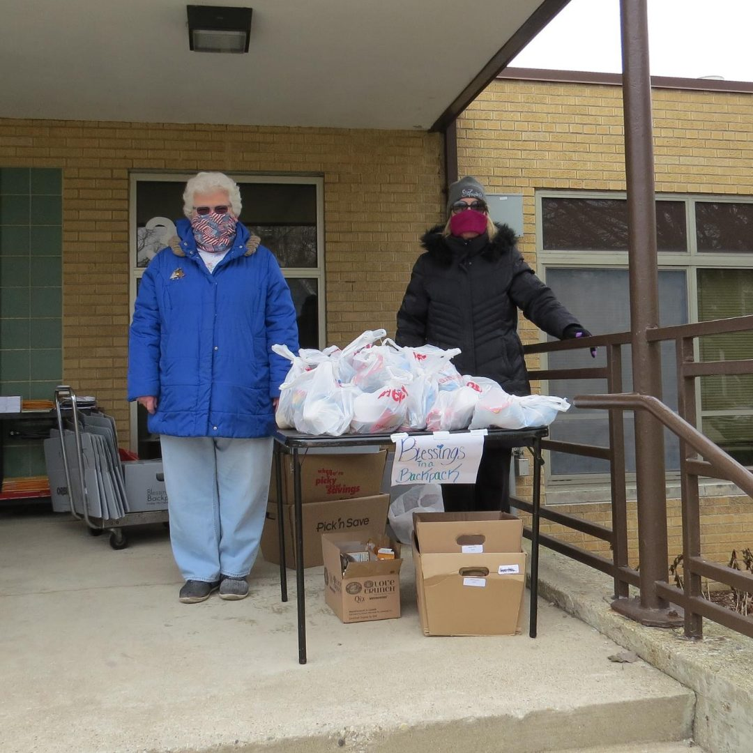 Volunteers handing out food during Covid closures